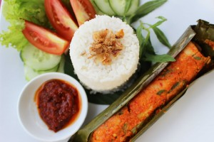 Pepes- Roast fish with traditional spices in banana leaf